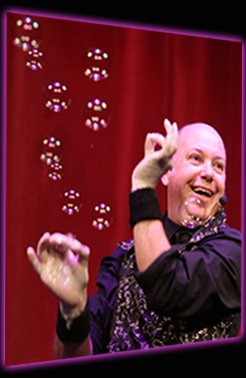 Believe A Bubble Show - Damian flicking bubbles out of his hands