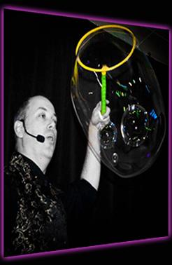 Believe A Bubble Show - Damian blowing smaller bubbles inside a large bubble